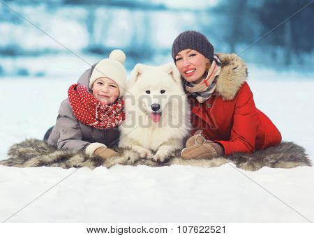 Christmas, Winter And People Concept - Happy Smiling Family, Mother And Son Walking With White Samoy