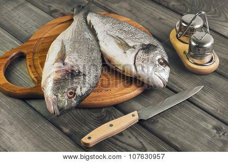 Wooden Table Cutting Board With Fresh Raw Dorado Fish