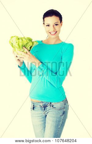 Portrait of attractive caucasian smiling woman with salat.