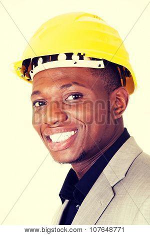 Happy successful businesman in helmet