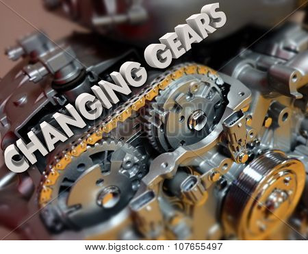 Changing Gears in 3d letters on a car, auto or vehicle engine to illustrate shifting a topic or increasing speed