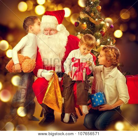 Santa Claus giving Christmas gifts to children. Santa and Happy Kids - Sister and Brothers. Cute little Boys and Santa Claus holding Giftbox. Christmas Holiday Scene over Decorated Christmas Tree