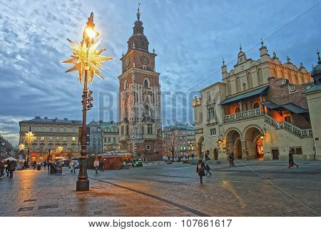 Krakow, Poland - January 9, 2014: Cloth Hall and Town Hall Tower in the Main Market Square of the Old City in Krakow in Poland at Christmas