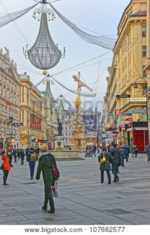 Holy Trinity Column And Graben Street In Vienna In Austria With Christmas Decoration In The Street