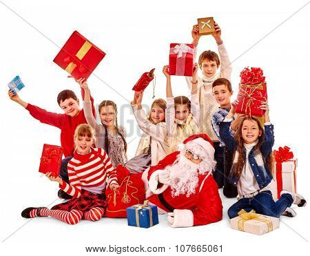 Group of children have diferent games with Santa Claus.  Isolated.