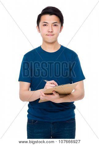 Asian man write on clipboard