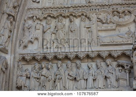 Paris - West facade of Notre Dame Cathedral. The Saint Anne tympanum