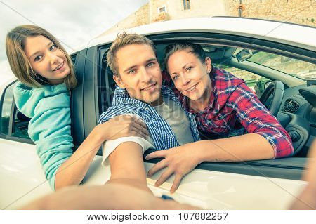 Handsome Guy Having Fun With Girlfriends - Best Friends Taking Selfie At Car Trip On The Road