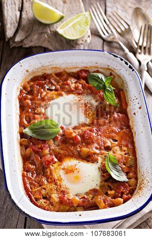 Baked eggs with vegetables and chickpeas