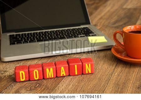 Domain written on a wooden cube in a office desk