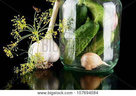 Cropped Shot Of Cucumbers In Jar Preparate For Canning Isolated On Black