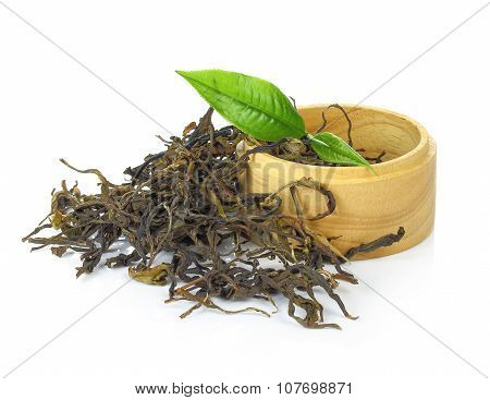 Black Tea With Leaf Isolated In Wooden On White Background