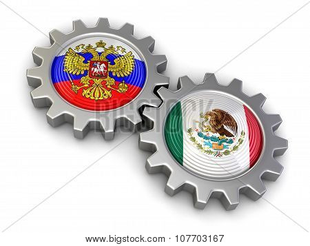 Russian and Mexican flags on a gears (clipping path included)