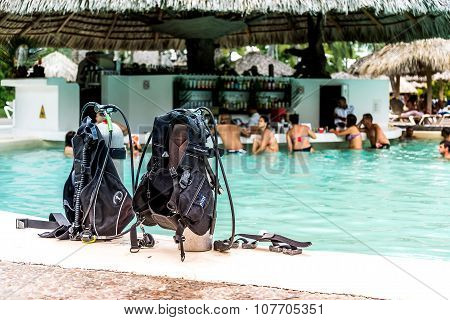 PUNTA CANA, DOMINICAN REPUBLIC - OCTOBER 3rd 2015: Two air cylinders waits on the edge of pool, behi