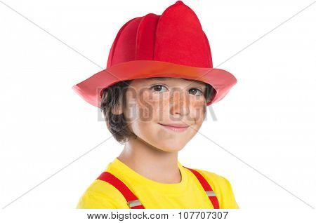 Closeup face of smiling boy wearing firefighter helmet isolated on white background. Happy cute boy smiling and looking at camera with his face dirty soot.