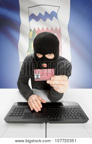 Hacker With Canadian Province Flag On Background Holding Id Card In Hand - Northwest Territories