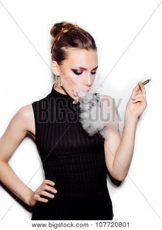 Portrait Of Fashionable Female Model With Cigarette Holder