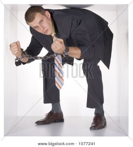 Chained Businessman In The Cube