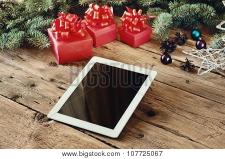 White Tablet With Christmas Presents Close Up