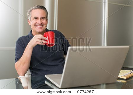 Casual mature business man working with coffee