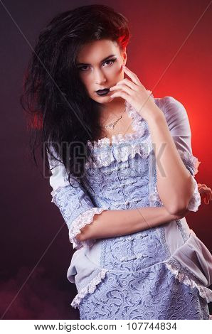portrait of halloween vampire woman aristocrat with stage makeup