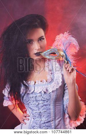 Beautiful Halloween vampire woman aristocrat with venetian mask