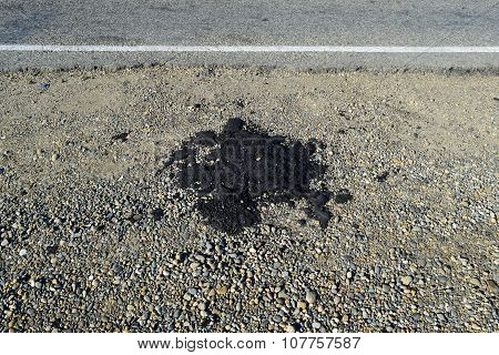 The Piece Of Fresh Asphalt Which Dropped Out On A Roadside