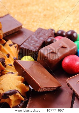 A lot of candies and cookies with brown cane sugar too many sweets unhealthy food reduction of eating sweets poster