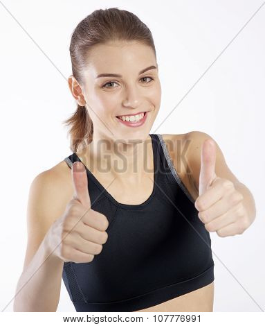 Beautiful young woman showing thumbs up on white background
