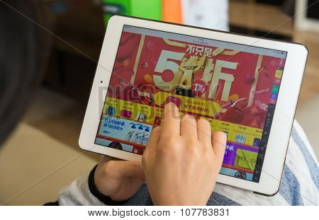 Zhongshan,china-november 11, 2015:yound Woman Shopping Through Tablet On Taobao On Chinese Online Sh