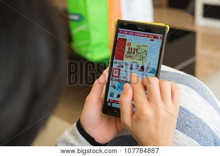 Zhongshan,china-november 11, 2015:yound Woman Shopping Through Mobile On Jd On Chinese Online Shoppi