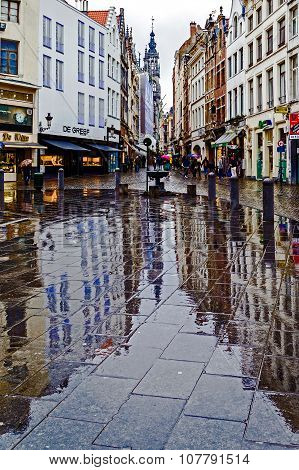 Reflections On The Pavement Street In A Rainy Day. Brussels, Belgium