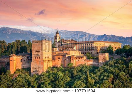 Ancient arabic fortress Alhambra at the beautiful evening time, Granada, Spain, European travel landmark