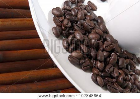 Coffee Beans In A White Plate