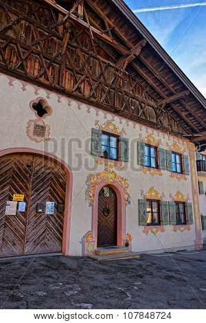 Garmisch-Partenkirchen, Germany - January 7, 2015: Charming houses with decoratively painted facades of Garmisch-Partenkirchen. Bavaria. Germany