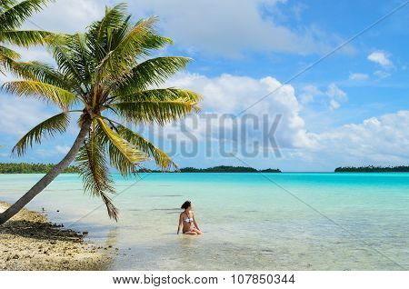 Female Bathing Under A Hanging Palm Tree