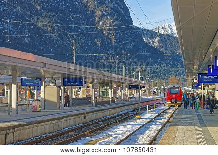 GARMISCH-PARTENKIRCHEN GERMANY - JANUARY 06 2015: View of the Garmisch-Partenkirchen train station on a sunny winter afternoon. Bavaria. Germany