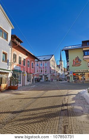 GARMISCH-PARTENKIRCHEN GERMANY - JANUARY 06 2015: Cozy street of Garmisch-Partenkirchen Bavaria Germany. The town well known for the beautiful facade paintings on the wall of the houses and shops