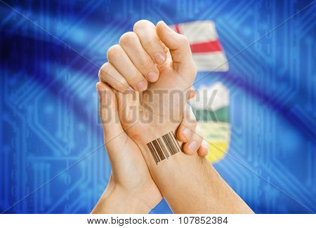 Barcode Id Number On Wrist With Canadian Province Flag On Background - Alberta