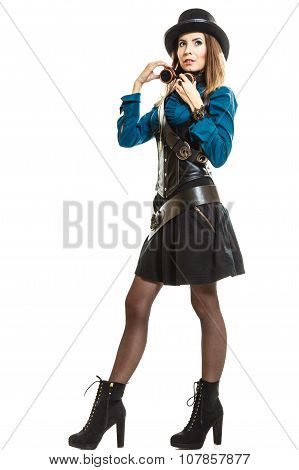 Young steampunk islolated girl on white wearing fancy hat. Fantasy old fashion with stylish topper and goggle. poster