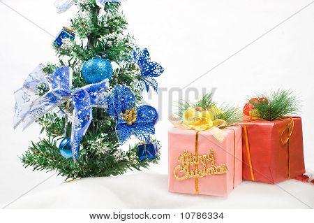 Christmas Greeting Gift Box Front Of A Christmas Tree