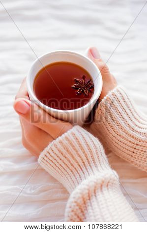 Women Holds A Cup Of Hot Tea With Anise Star. Cozy Morning At Home.