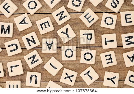 A Background Of Various Tan Letter Tiles