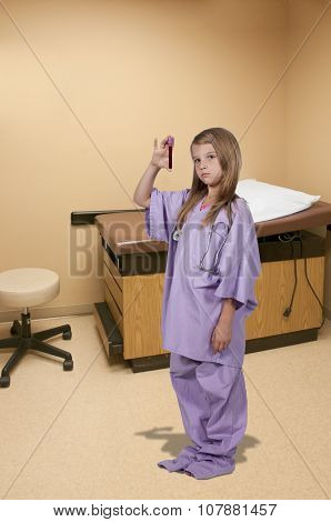 Little Girl Nurse With Blood Sample