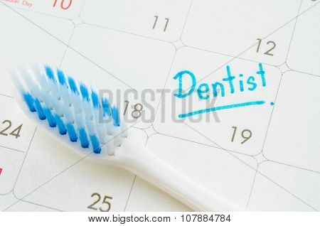 The Words Dentist Written On A Calendar.