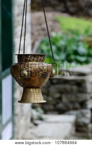 Old metal hanging incense-burner with swarga ornament Asia, Himalayas, Nepal, everest region