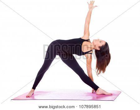 Beautiful woman doing Parivrtta Trikonasana  pose on yoga class, Studio shot.