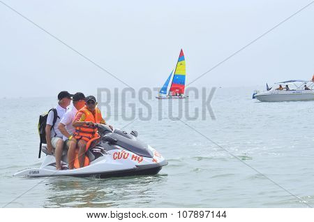 Nha Trang, Vietnam - July 11, 2015: Preparing the jetski for travellers on the beach of Nha Trang ci