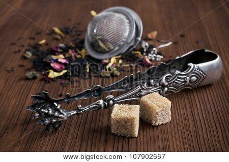 Herbal Tea, Tea Strainer, Sugar Cubes And Tongs