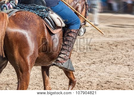 The Spaniard Rider On Horseback. The Leather Boots.